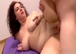 Busty curly chick gets fucked on couch