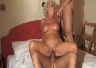 Two men fuck a lusty as hell mother