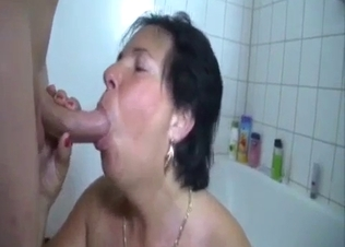 Busty old mom gives her son a good blowjob