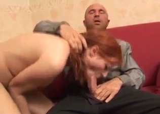 Redhead daughter sucks her father's boner