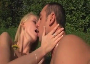 Blonde babe is enjoying doggy style sex