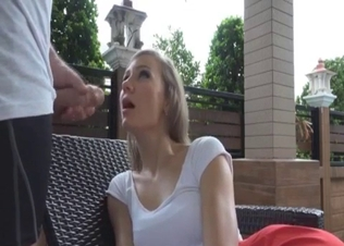Blonde beauty is sucking a huge sausage