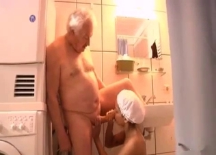 Good-looking young daughter sucks her old dad
