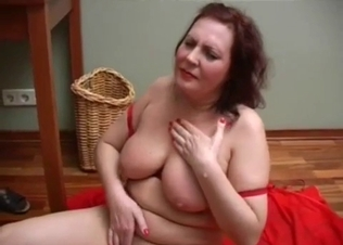 Busty redhead mom is sucking on the knees