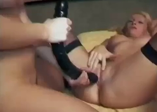 Two busty sisters fuck with a big toy