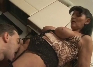 Busty mom sucks a big boner of her son