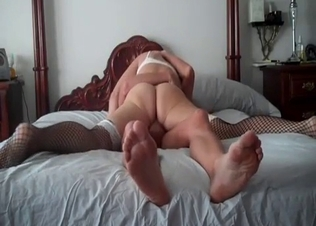 Tattooed brunette rides her son dick