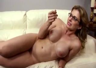 Babe in glasses sucks a massive boner