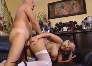 Blonde beauty is sucking a huge boner