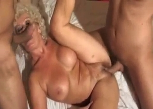 Two men fuck their big-boobed blond mom
