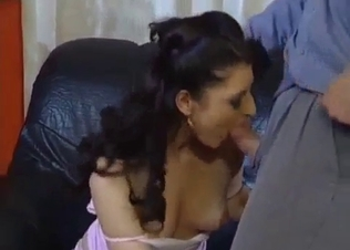 Busty brunette is playing with a huge dick