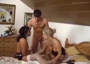 Stunning hotties are sucking a big cock