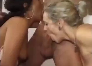 Stunning hotties are sucking a big cock