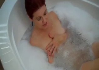 Redhead mom with amazingly big boobies