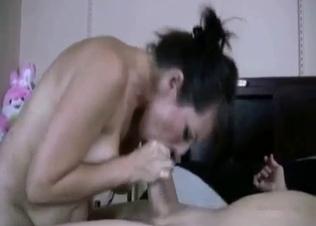 Awesome brunette sucks a huge sausage