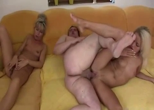 Two blondes perform a double blowjob