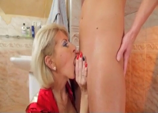 Busty stepmom sucks her son on the knees